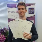 Learner Jesse Wall receiving his certificates for completing the social media apprenticeship